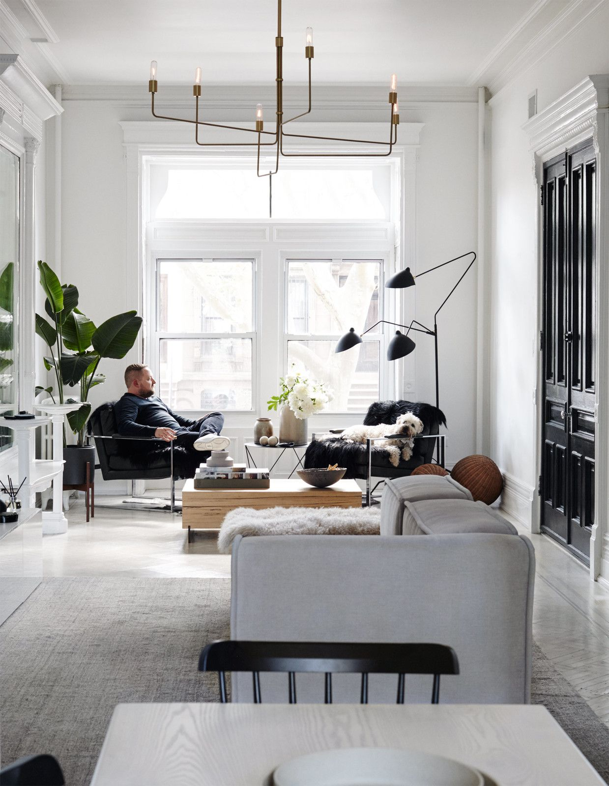 Jason lounges in one of two armchairs by midcentury designer Milo Baughman in…
