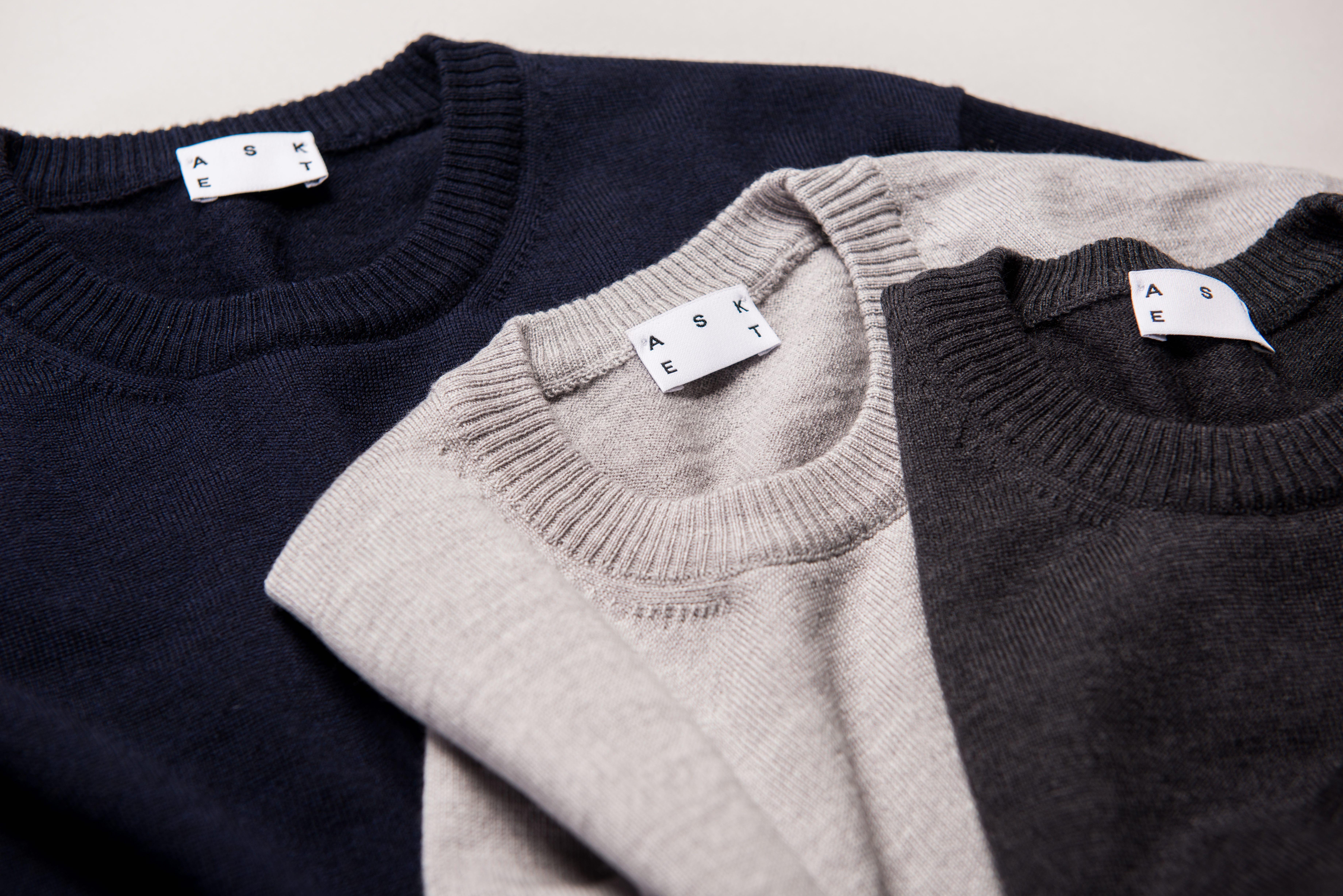The Merino Sweater in Dark Navy, Light Grey, and Charcoal