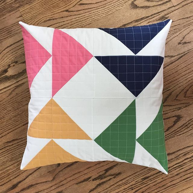 A look at the half square triangle pillow that we will be making at #snapconf this weekend. I just finished cutting all the batting and am packing up! And don't worry I cut a few extra kits so we could give some away as well next week to you . #HST #quilt #quilting #sew #sewing #learntoquilt #babylocksewing #confetticottons