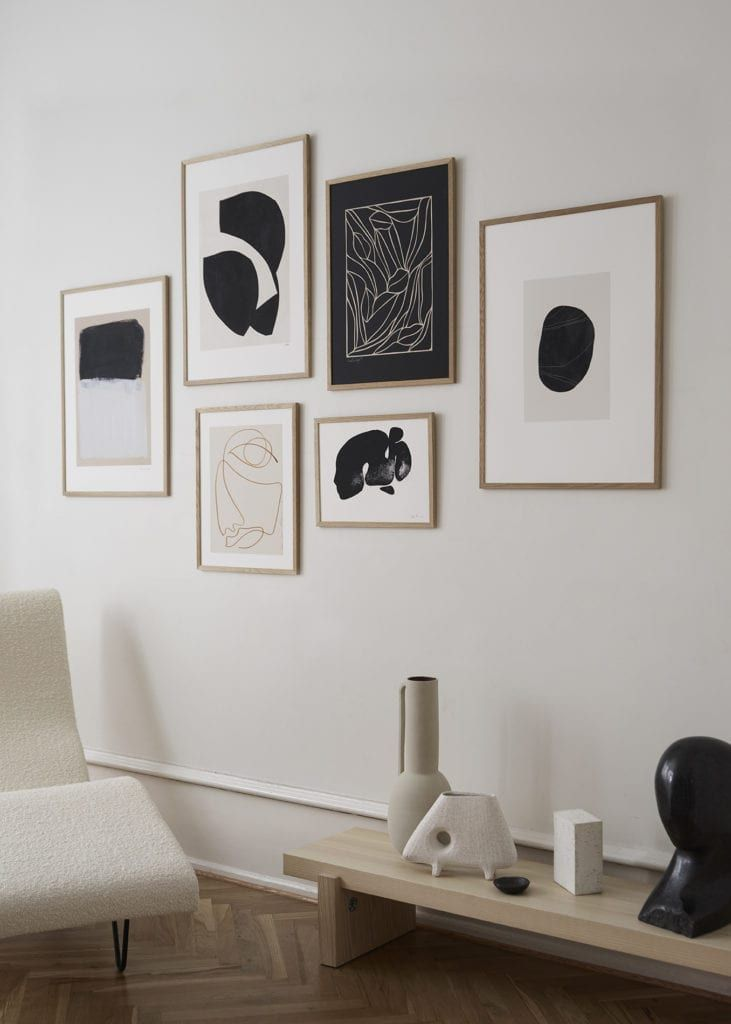 With a combination of design prints from different origins, in different sizes, and framed in beautiful oak wood frames, we have mixed and matched art prints that compliment each other, as well as the space they're put into. As an example of how opposites attract, this edit embraces the wide spectrum of art, with a strong Nordic influence in interiors. Click to see more inspiration on how to create a perfect art wall! #art #artprint #artposter #theposterclub #artwall #scandinavianliving