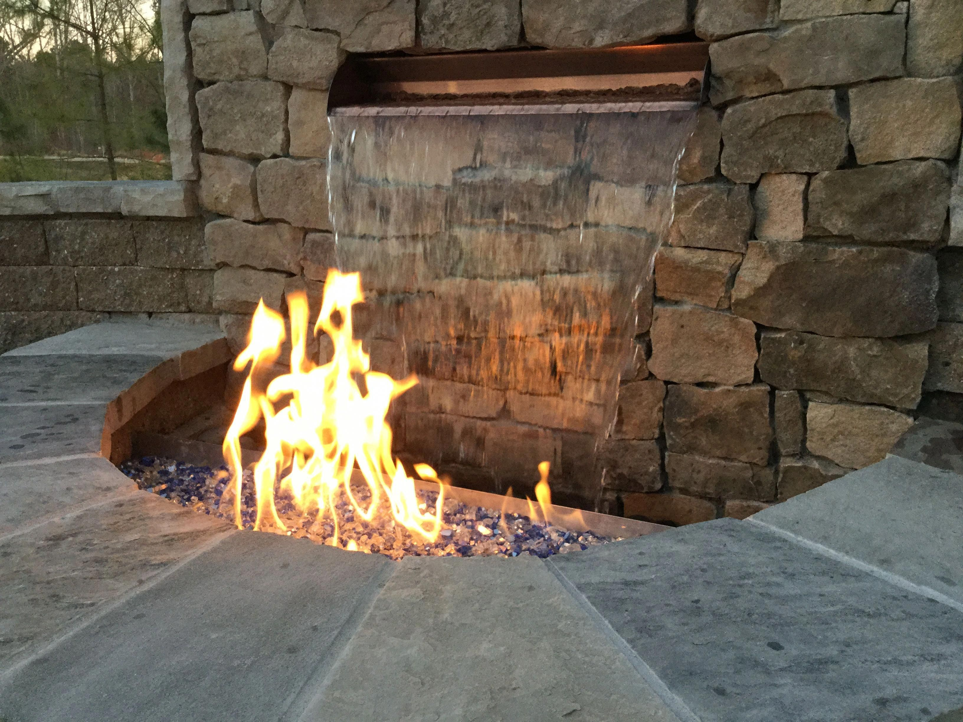 Garden fire features  Outdoor Living Designs Custom paver patio and fire pitwater