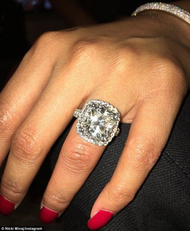 Nicki minaj shows off an even bigger ring on her wedding finger nicki minaj shows off an even bigger ring on her wedding finger junglespirit Image collections