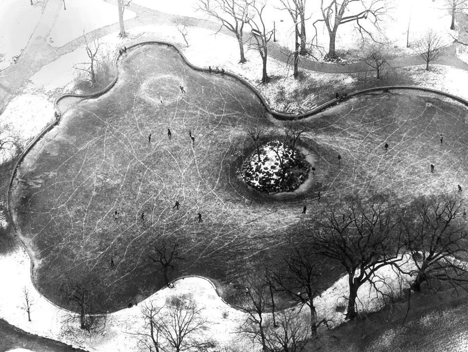 Boston, Jan. 18 1975: An aerial view of skaters on the Public Garden lagoon, where in the summer you would see the Swan Boats.
