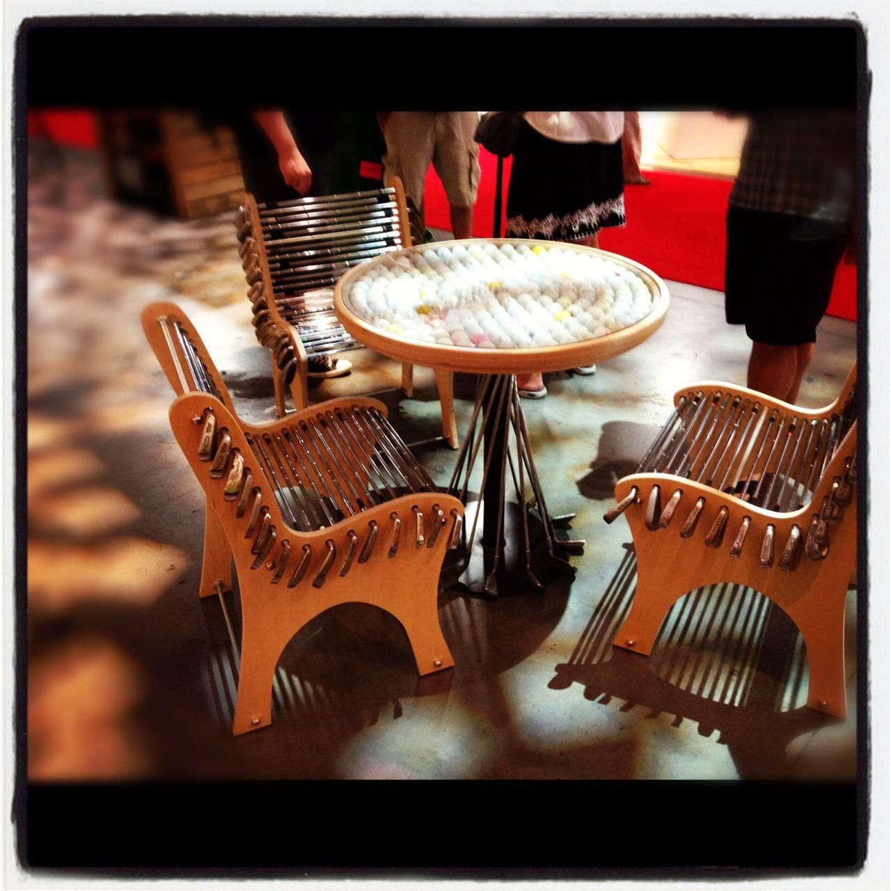a golf ball table and chairs made out of golf clubs golf clubs