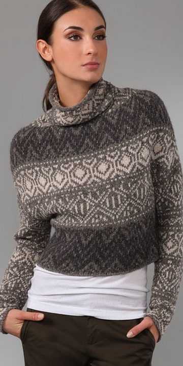 *  This cropped, Fair Isle wool sweater features a rolled edge at the turtleneck. Long sleeves.