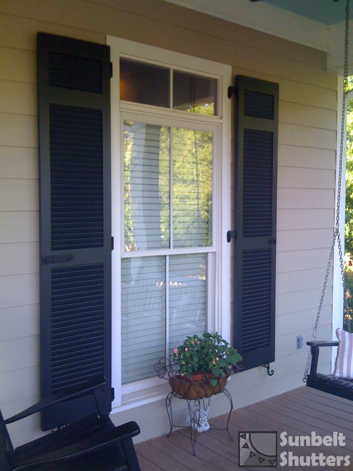 Top section of louvered shutter nicely aligns with transom - Exterior louvered window shutters ...