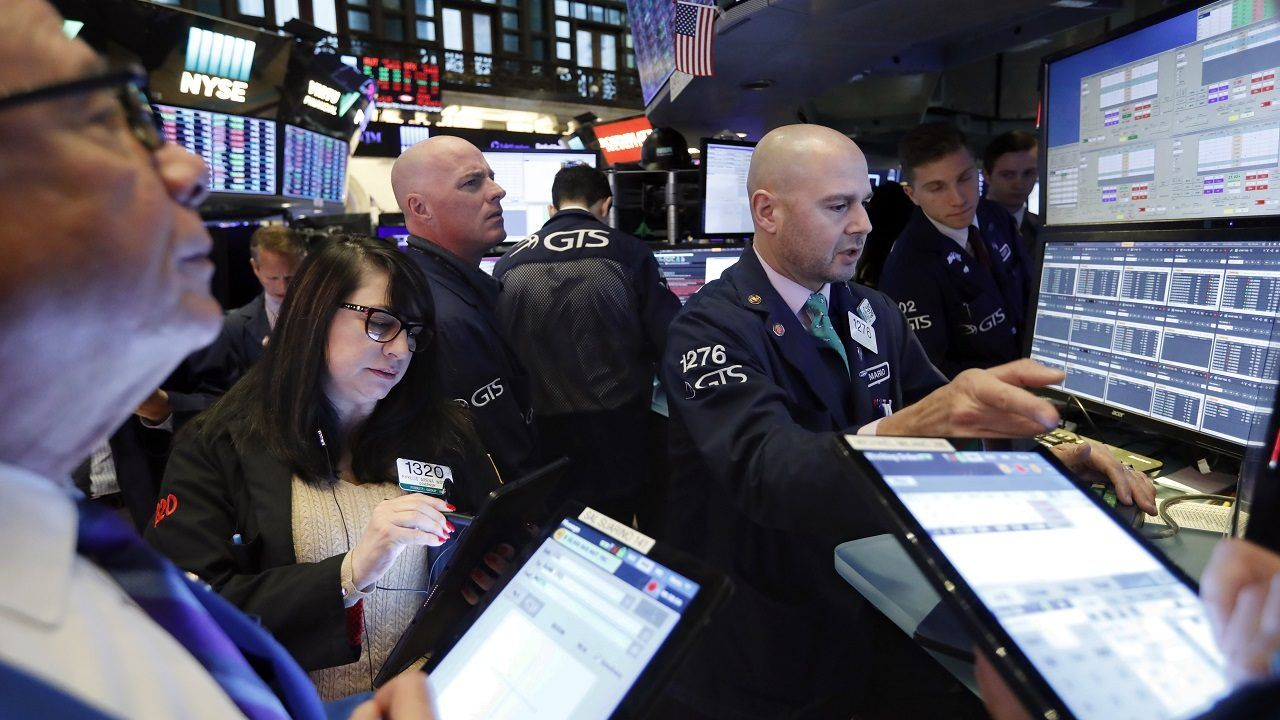 Stocks hold near record highs as they look to extend the