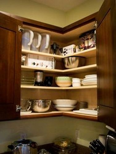 How To Organize Upper Corner Kitchen Cabinet 5 Guides Using The Right Storage Solution Corner Kitchen Cabinet Kitchen Cabinet Storage New Kitchen Cabinets