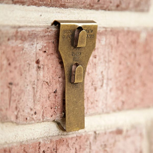 Hanging Pictures On Brick Wall How To Hang Tools Guide Brick Clips Exposed Brick Walls Brick Wall