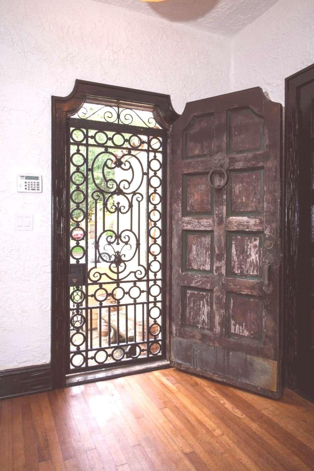 This Oversized Rustic Entry Door With Wrought Iron Gate Is Absolutely Dreamy This Oversized In 2020 Rustic Doors Iron Front Door Garage Door Design