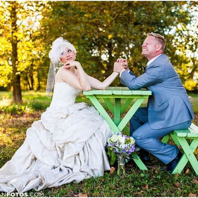 One of our sample sale brides kicking butt in a vintage Eugenia #southernbell #armwrestle #bridephotos