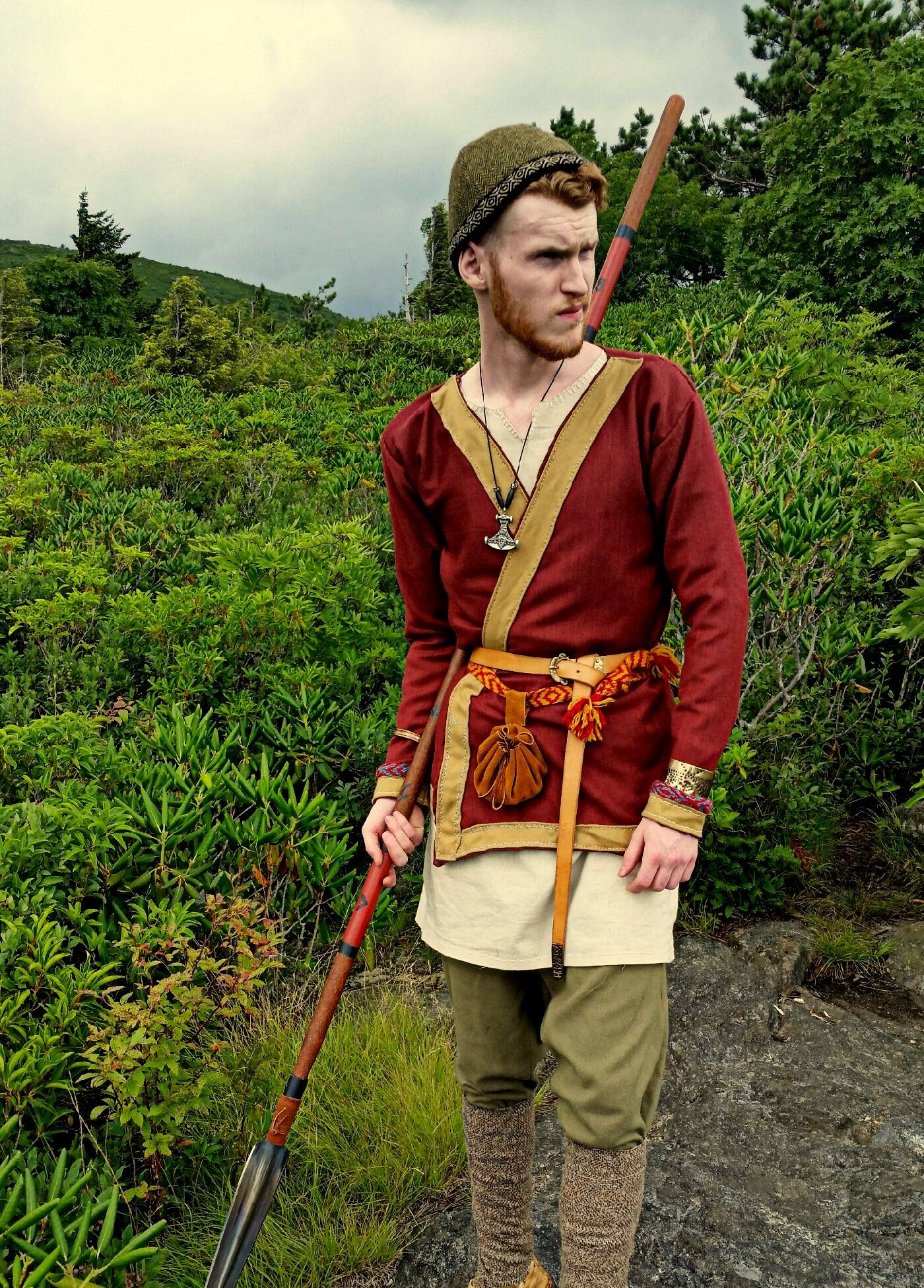 "In a complete break from the ""typical"" Norse tunic style, two tunics were discovered in Birka, Sweden, as well as Hedeby, dubbed the Hedeby Klappenrock. Unlike the pull-over styles, these tunics were were split up the front at a diagonal angle, so as to create a double-breasted shape. The sides overlapped and the tunic was closed with a belt."