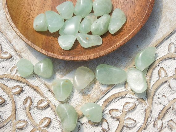Check out this item in my Etsy shop https://www.etsy.com/listing/287135759/prehnite-tumbled-healing-stones