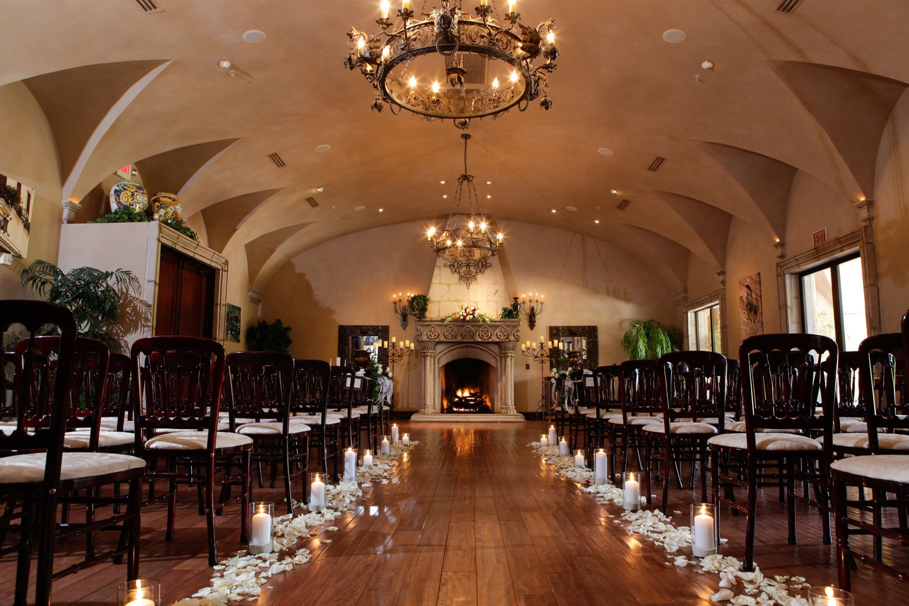Indoor Wedding Themes: White Pillar Candles Surrounded By Matching Candles