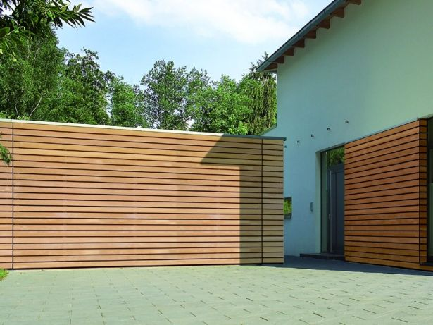 Designer garagentor  Designer Carport & Stellplatz: Seitenansicht eines Carports aus ...