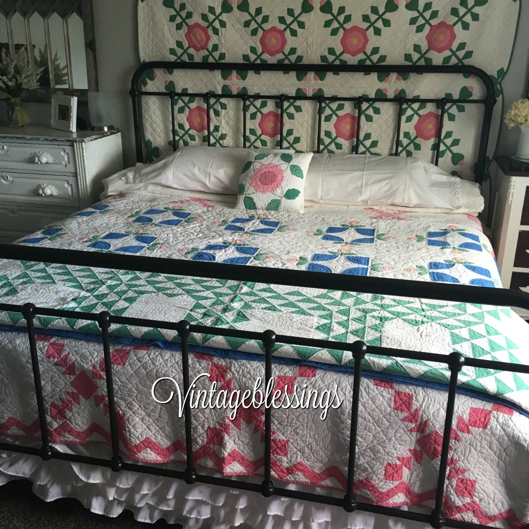 Loving the vintage cottage bedroom.all these quilts are