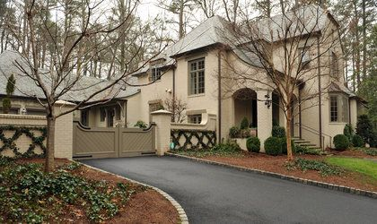 Tara Dillard:  Foot traffic already showing where a path should be placed.  For the car not getting into the gate, a quick step out to the front steps, or forgetting something once heading out.  Another pair of boxwood of course !   Stan Dixon, architect