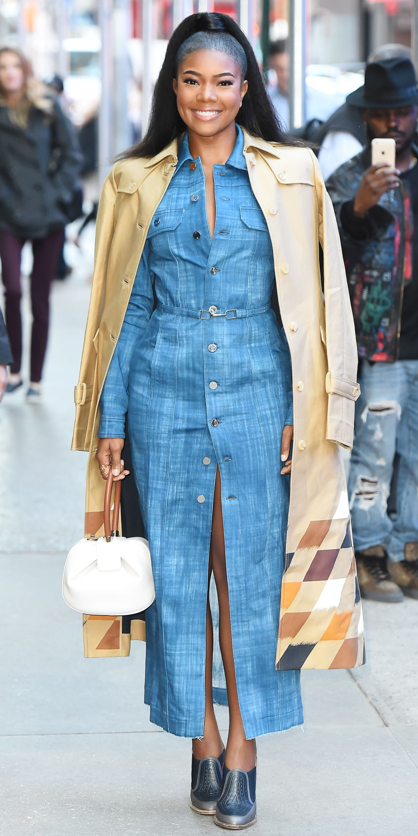 a03cdb9894a1 Gabrielle Union attended Good Morning America in the chicest denim dress  with a trench coat effortlessly draped over her shoulders.