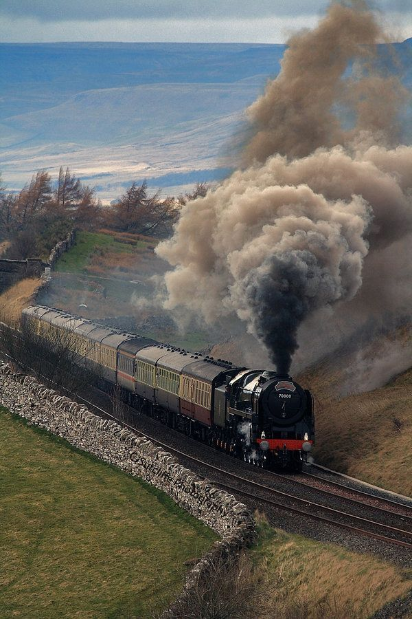 British Railways Standard Class 7 Pacific heads a mainline special (possibly on Settle & Carlisle line).