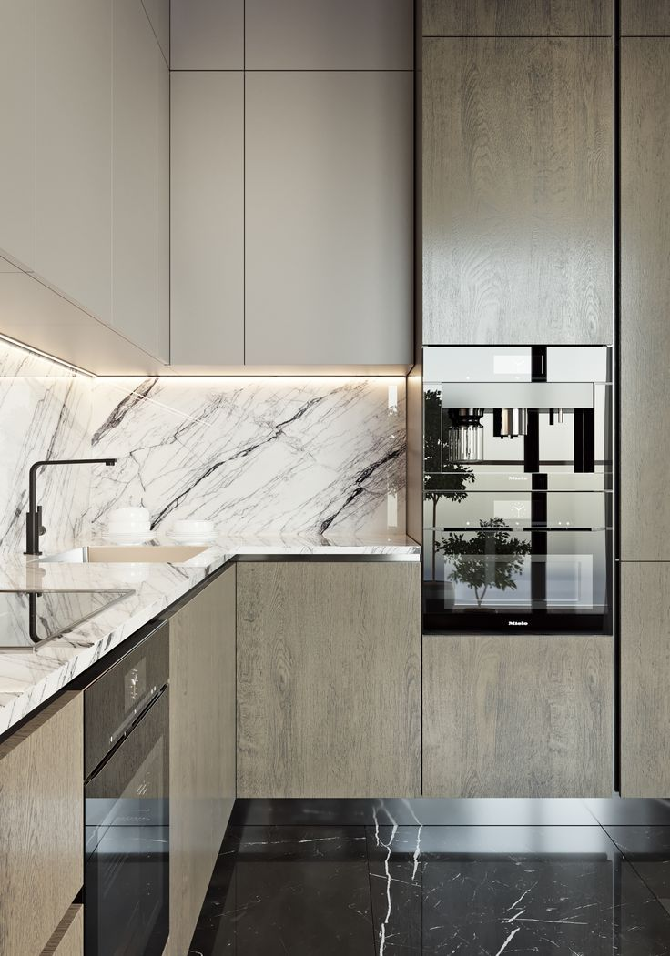 Loving The Marble Backsplash Of This Modern Kitchen With Black
