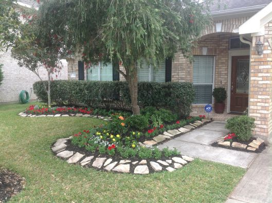 fresh plantings to spruce up flower bed along walkway front entry