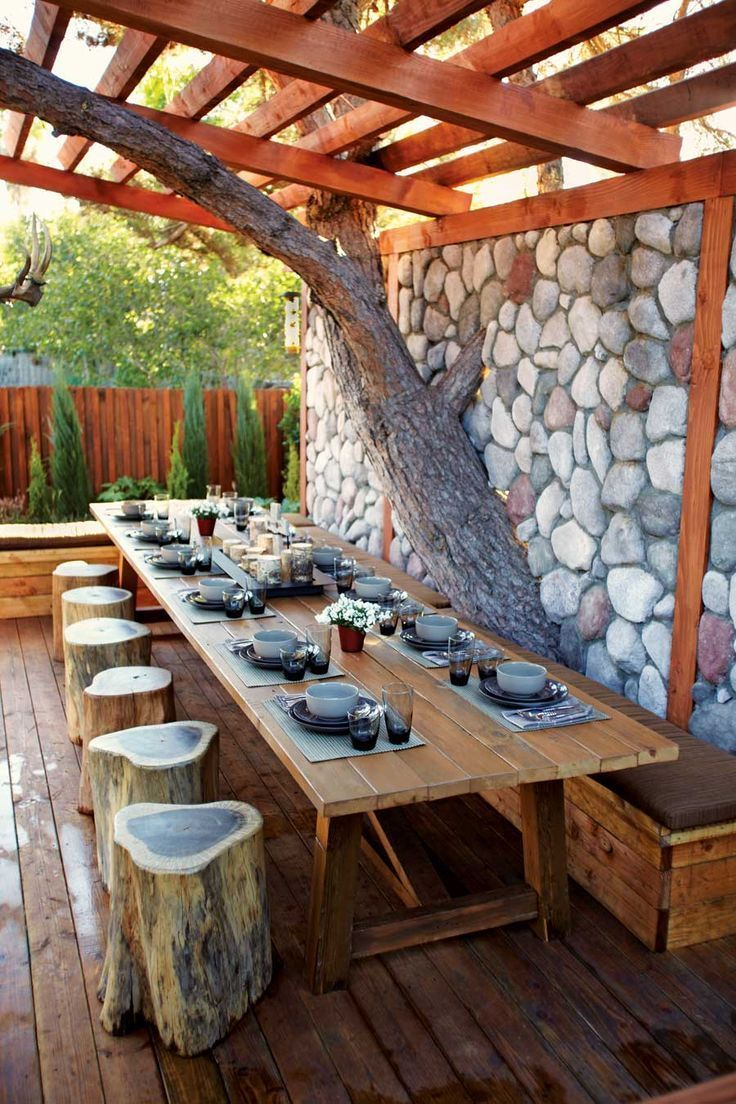 Rustic outdoor dining area look at that amazing tree wall