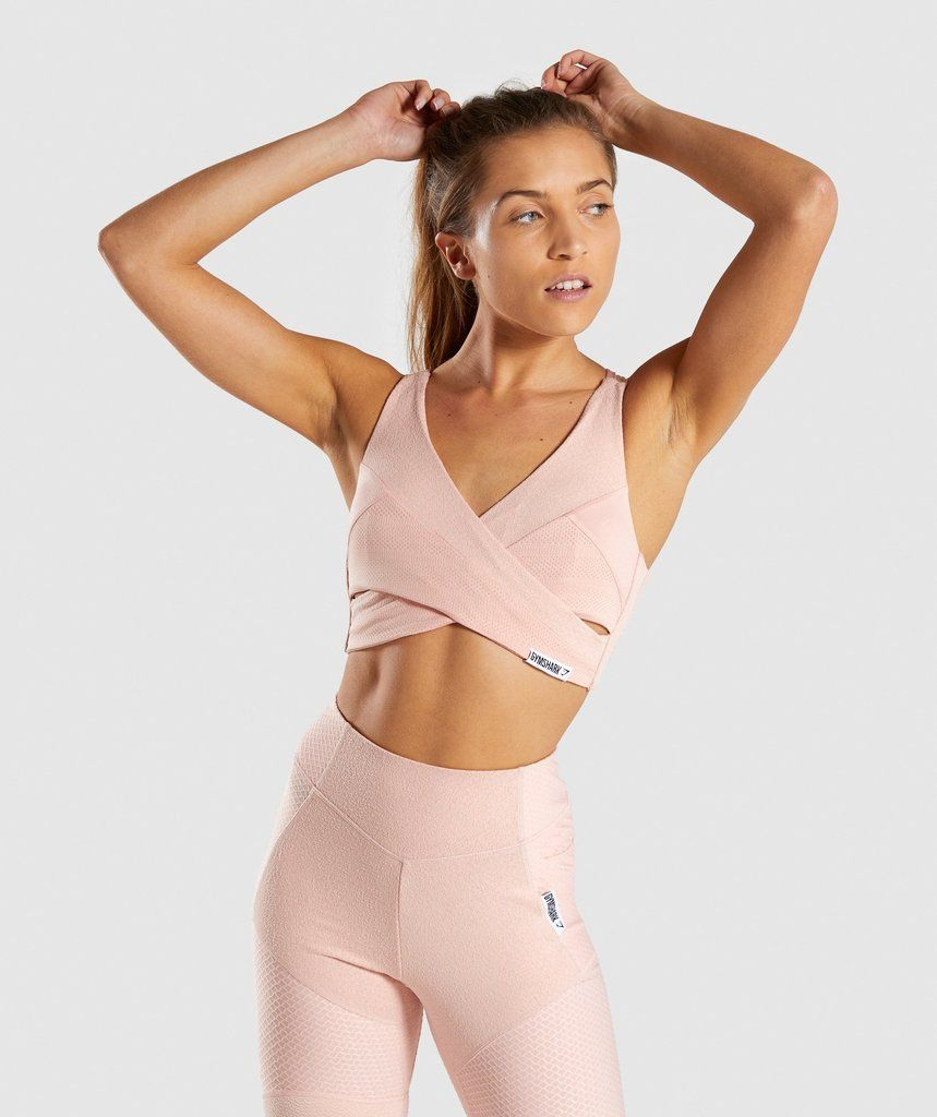 2c6ecf064a72e Comfort with character. - Multi-fabric blend - Cross over panelling to  front - Dipped neckline - Cross over bow straps to back - Removable padding  - Tab ...