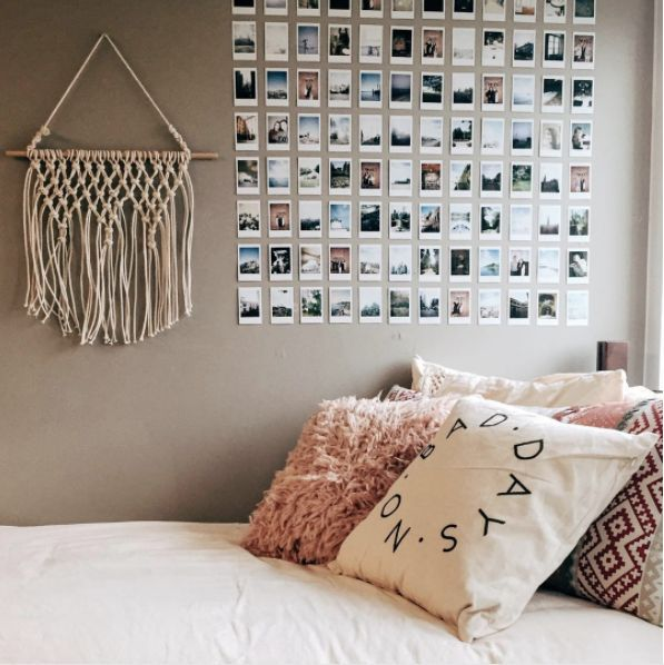 Photo of This perfect wall decor that is so pleasing to the eyes. (Not one crooked polaroid!).