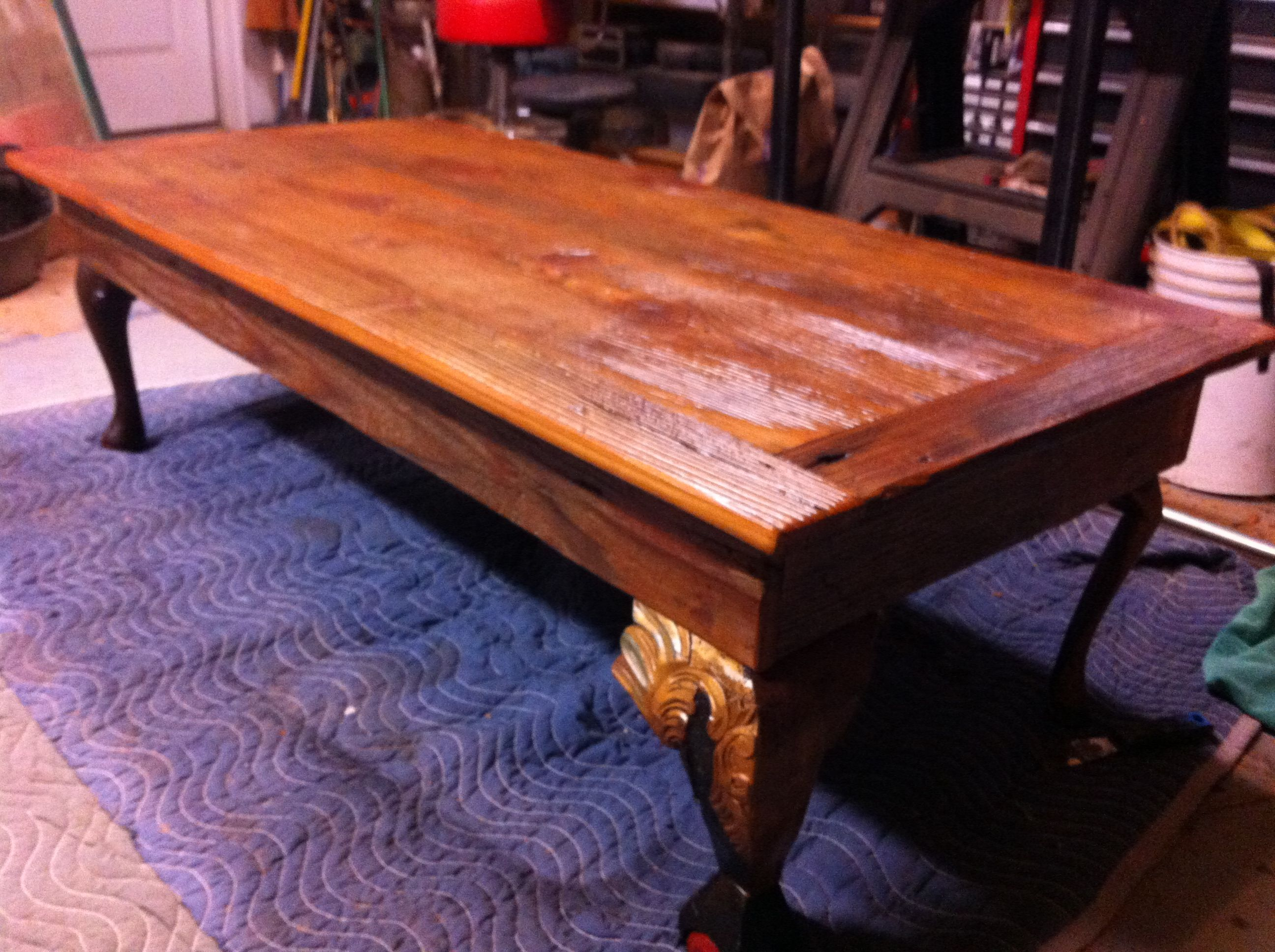 Recycled flooring coffee table top with miss-matched legs for character.