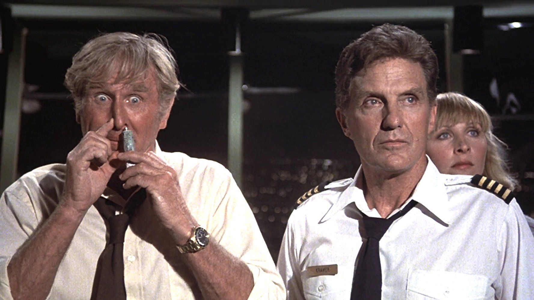 Lloyd Bridges, Robert Stack, and Lee Terri in Airplane