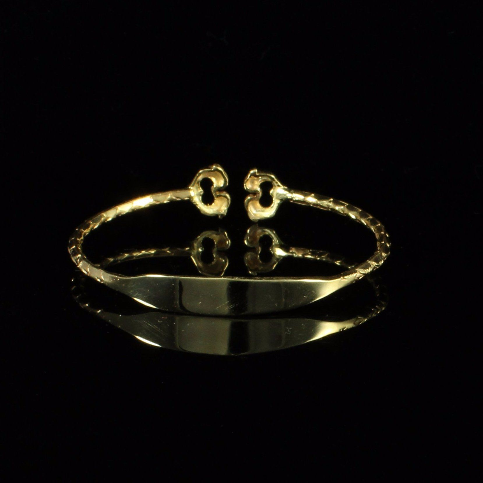 Engravable west indian bangle with dolphins handmade in k