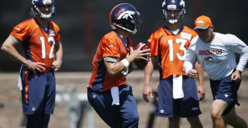 Denver Broncos quarterback Mark Sanchez, front, drops back to pass as, from back…
