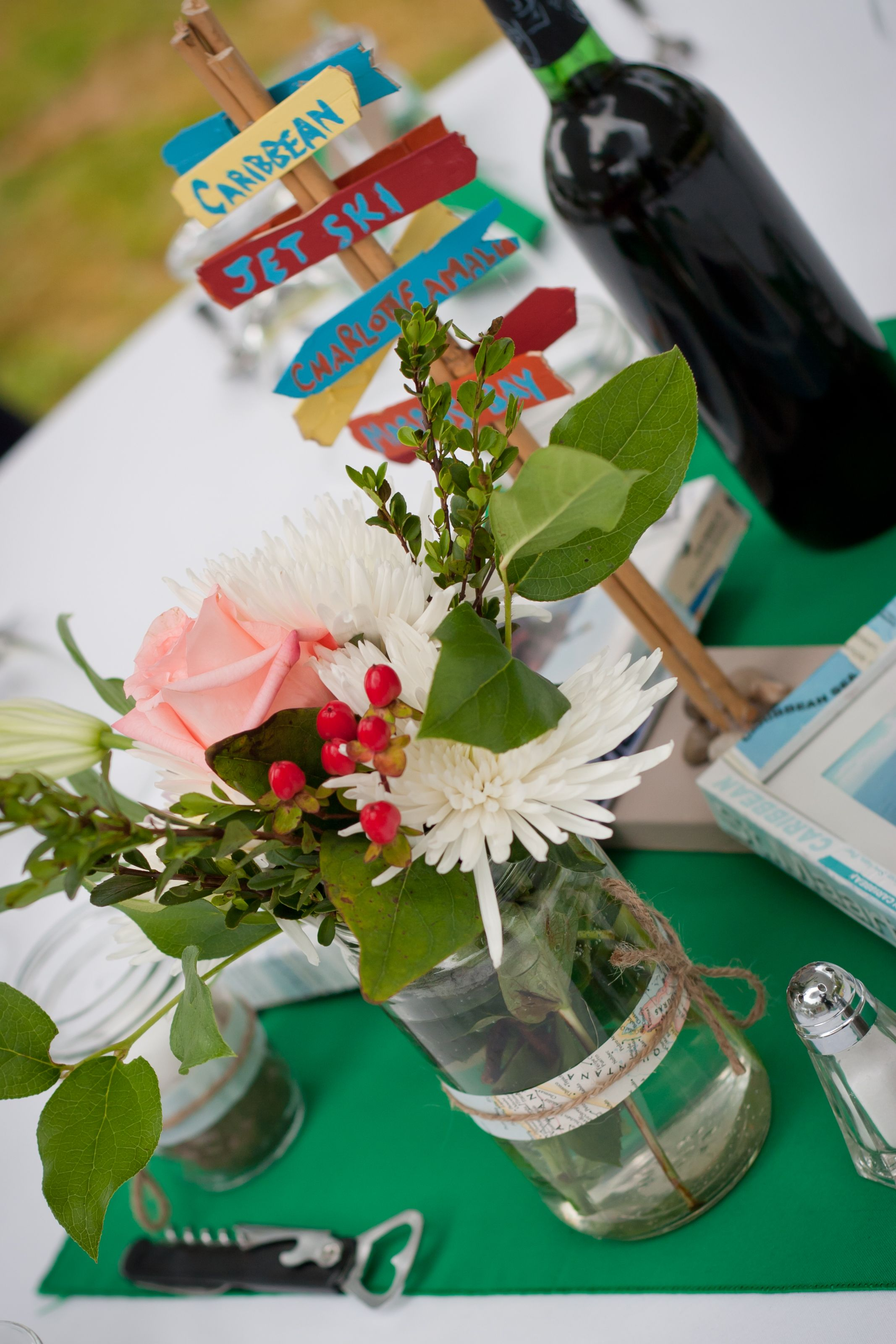 Rustic travel themed wedding centrepieces