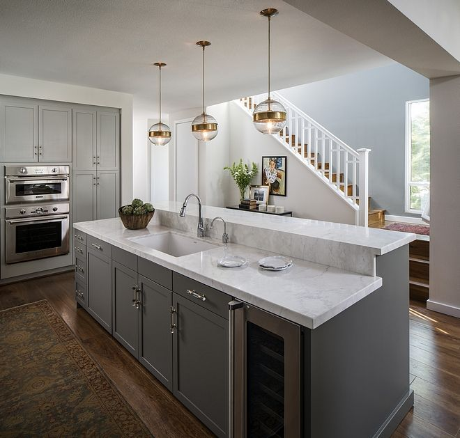 Kitchen Island Features Bar Height Counters With Crema Delicato Honed Marble Counterto Kitchen Design Countertops Kitchen Island Bar Marble Countertops Kitchen