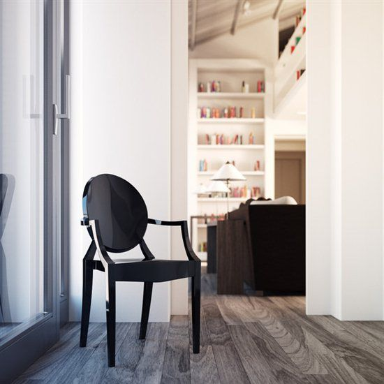 Black Acrylic Chair On Gray Hardwood Floors And White Walls