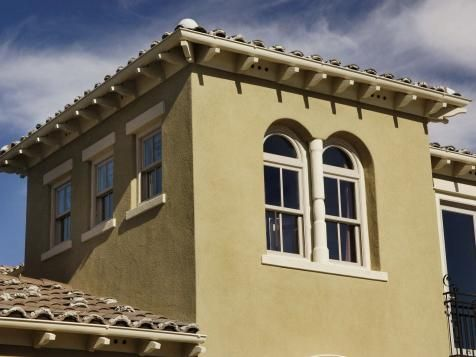 Clay S tiles reinforce the architecture's authenticity in this sandy stuccoed Italianate home.