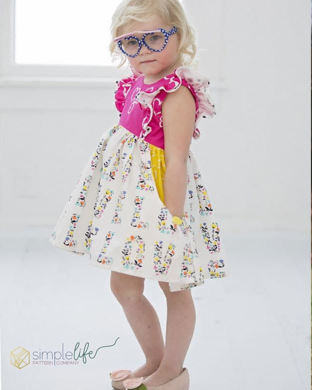 Jaimesyn's Double Flutter Pocket Top + Dress is part of Clothes Patterns Kids - Jaimesyn's Double Flutter Pocket Top + Dress   The Simple Life Pattern Company   Download pdf sewing pattern and start making beautiful, girls' clothes