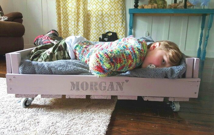 Morgan's new bed made from old pallets...Casey likes it too
