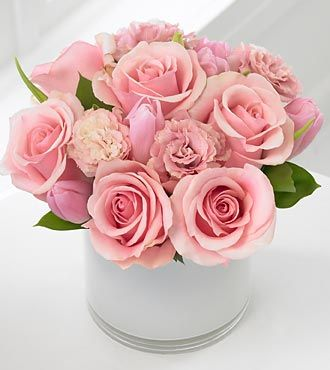 Pretty pink roses, light pink tulips and delicate pink lisianthus accented with deep green Italian ruscus.