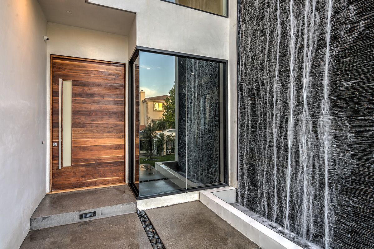 Stunning new modern construction home that sets the standard in this highly desirable pocket of Hollywood. Featuring 5 Bedrooms, 5.5. Baths, Thermador appliances, and an open floorplan, this designer home boasts all that the most-discerning buyer looks for. A gourmet kitchen is ready for chefs of all calibers to work in. Pocket doors lead the … Continued