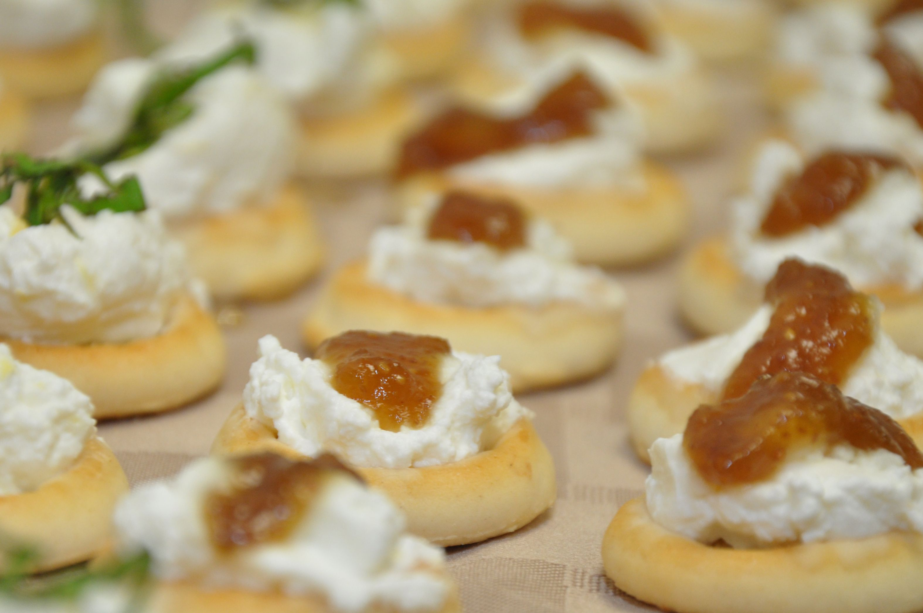 Delicious ricotta canapes made wit fig jam, and with lemon and basil....