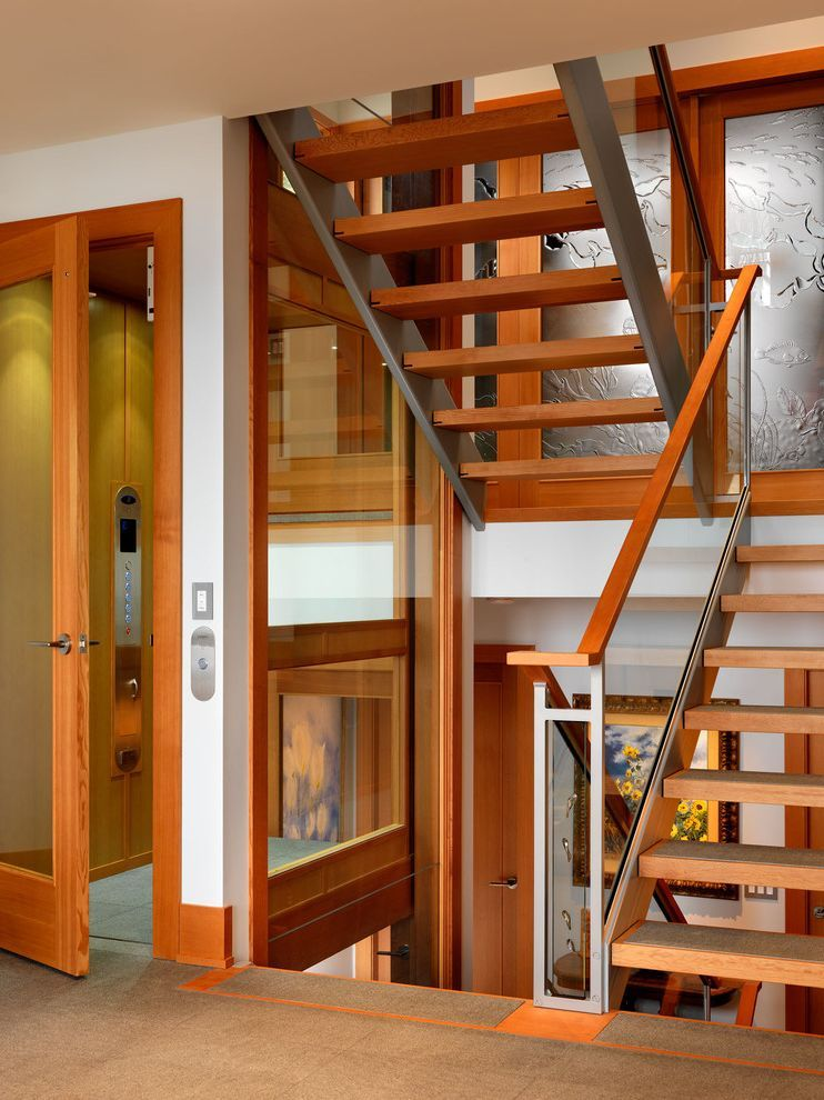 Best Home Elevator Cost With Contemporary Staircase Also Baseboards Elevator Glass Railing Open 400 x 300
