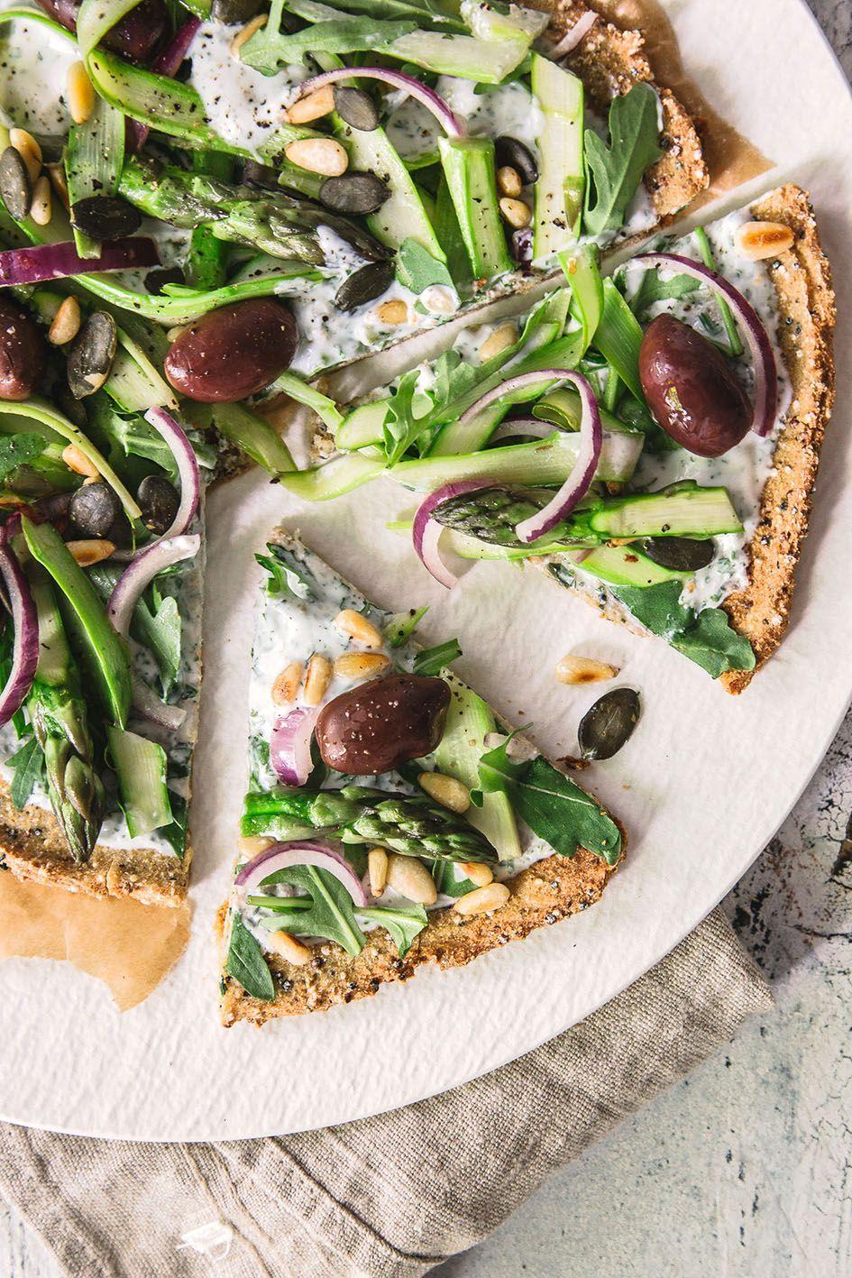 Quinoa pizza dough topped with green asparagus -  Quinoa pizza dough topped with green asparagus  -