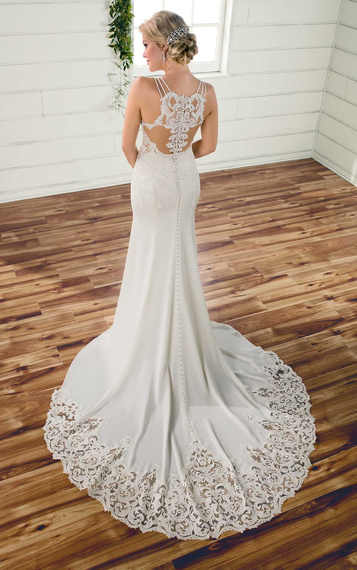 Simple lace and crepe wedding dress available at The