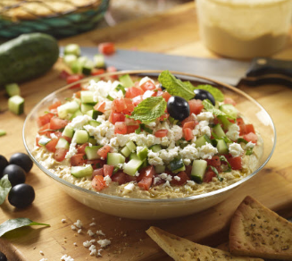 Fresh Take Mediterranean Layer Dip Recipe     • Tub of Zoës Hummus     • Diced and drained tomatoes     • Diced cucumbers     • Crumbled feta     • Diced olives     • Basil for garnish     • Zoës Pita Chips (white or wheat)  Spread hummus across bottom of   shallow bowl or dish.  Layer with diced tomatoes, cucumbers,   olives. Sprinkle with crumbled feta.   Garnish with fresh basil.