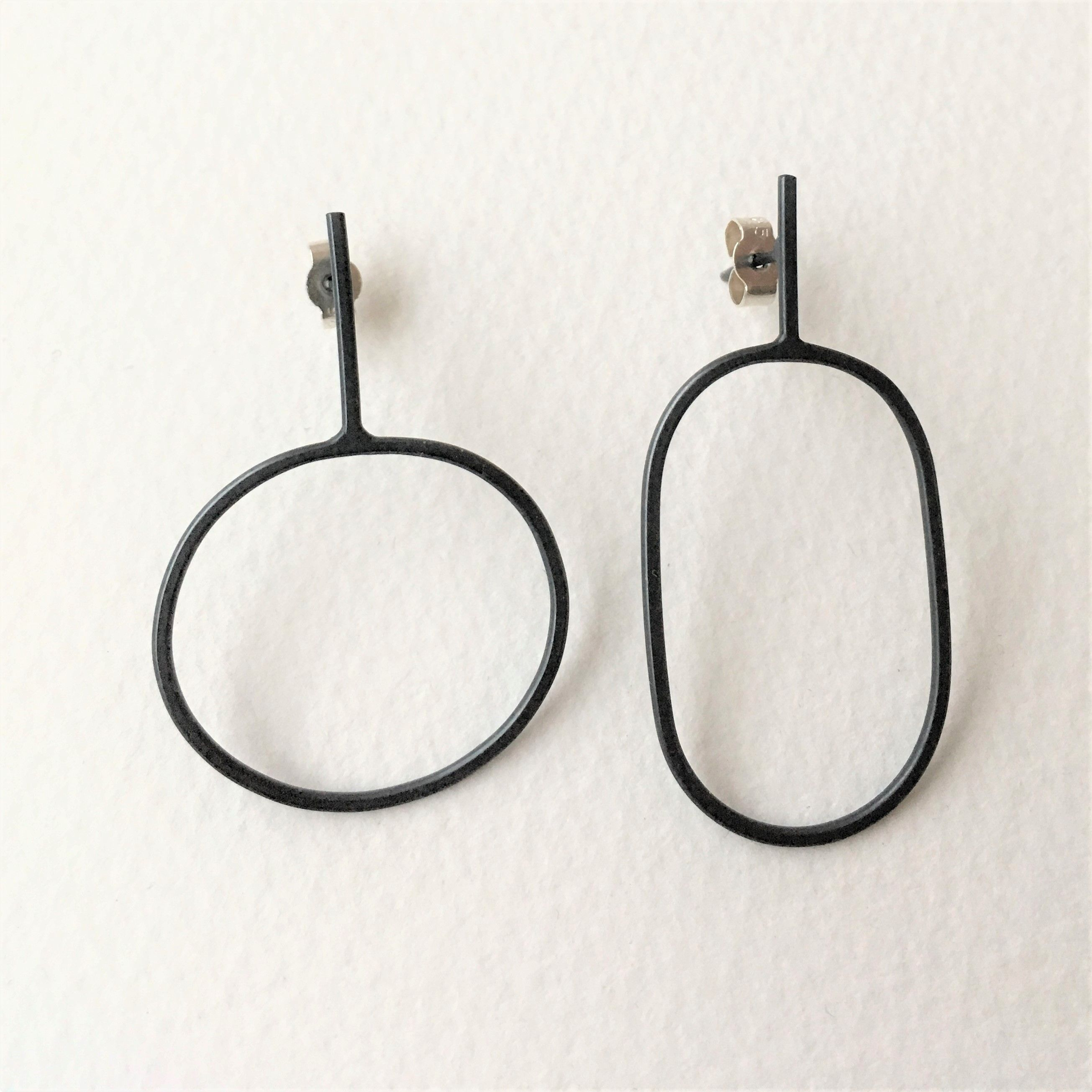 by shop debbie earrings contemporary long swirl silver siver