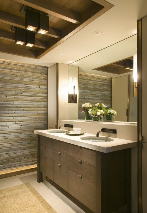 Stacked stone tile wall, wood storage vanity, woven natural fiber ...