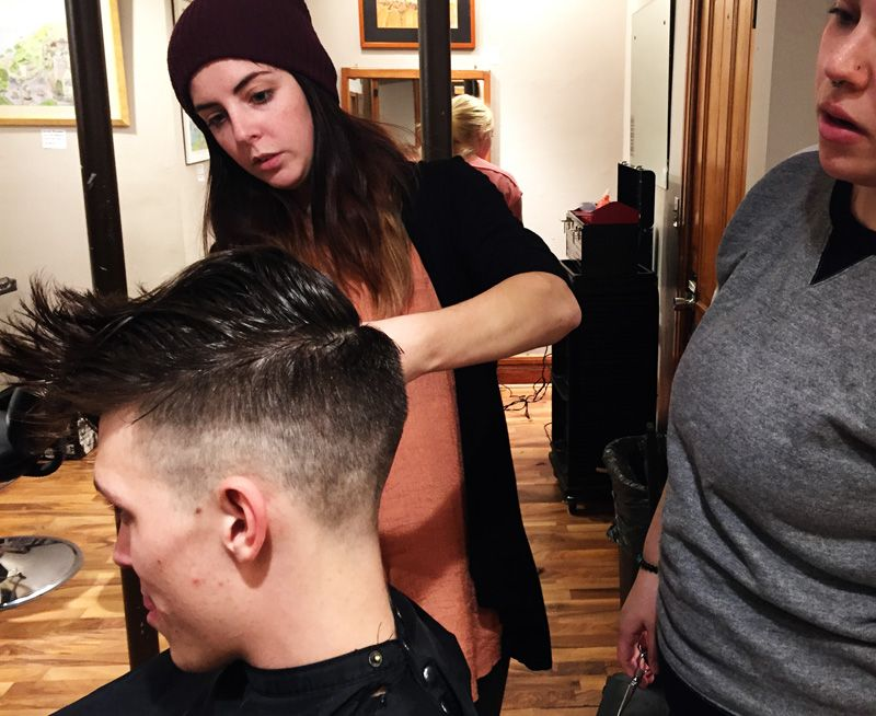 Beauty educator, Ashley R., taking students through the finer points of men's cutting.