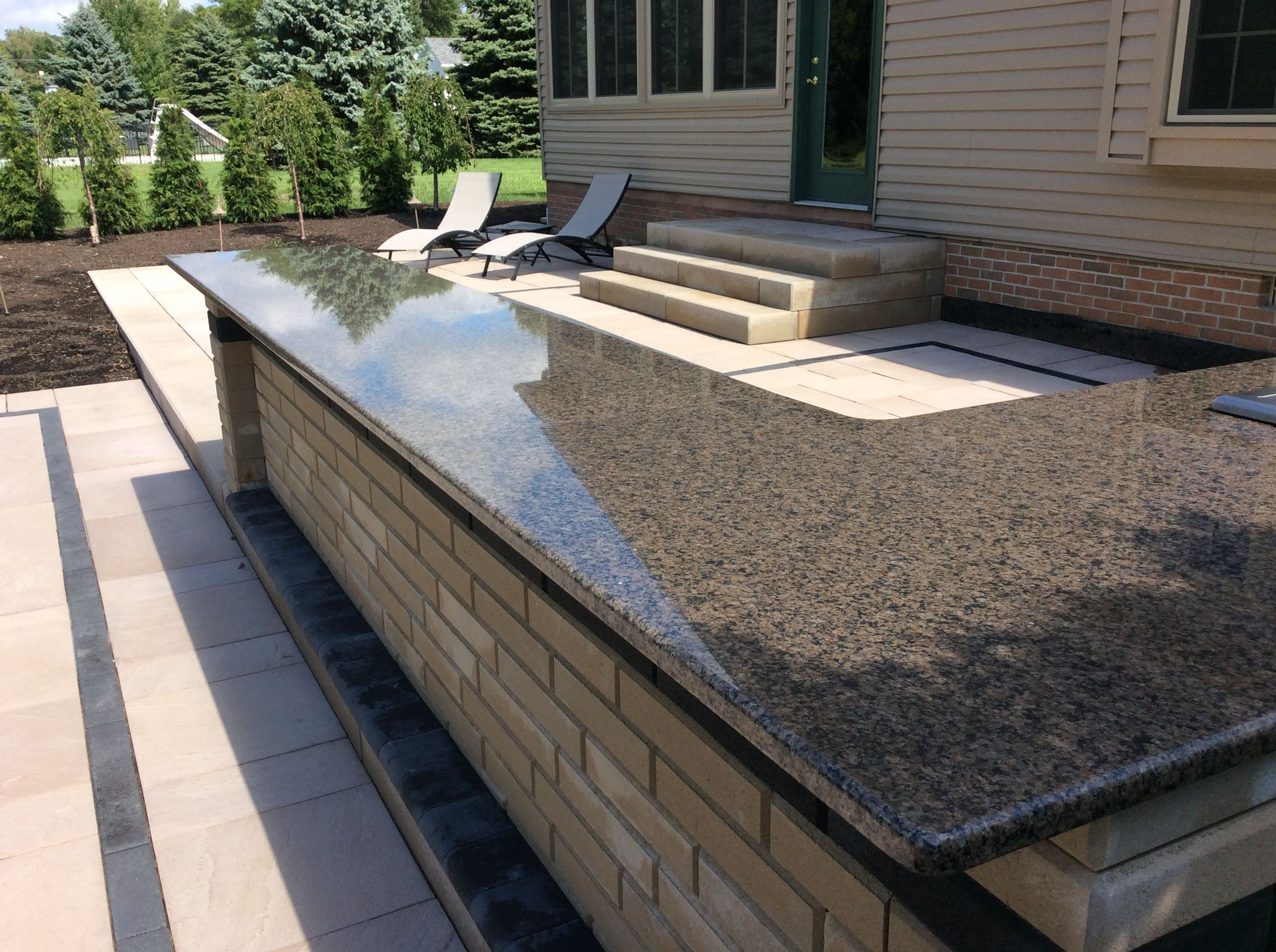 1 100sf Two Tiered Paver Patio With 10ft Long Bar Drop In Cooler Rectangular Fire Pit And Large L Shaped Sitting Wall Wi Patio Patio Bar Landscaping Blocks
