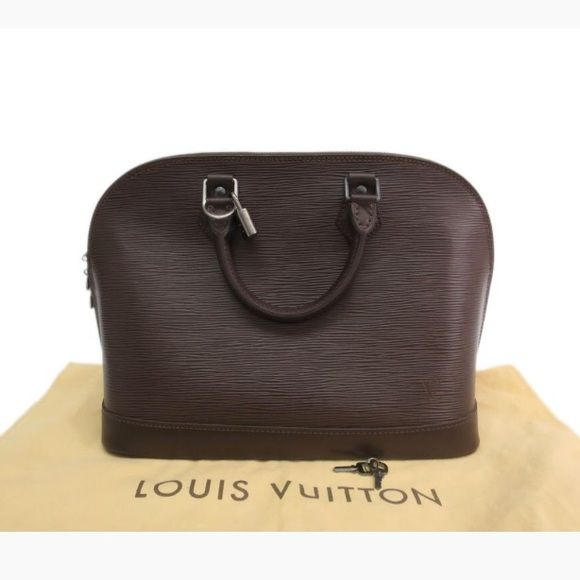 """Louis Vuitton Alma Epi leather mocha color bag. Louis Vuitton Epi leather mocha color bag. Date Code: MI0090 Size: W:12.6""""(32cm) / H:9.4""""(24cm) / D:6.3""""(16cm) Length of Handle: 11.0""""(28cm) 1 Inner Pocket  Accessories: Original Dust bag /  Slightly scratched and unnoticeable black marks inside as shown on the photos  Overall in Very good condition Louis Vuitton Bags Hobos"""